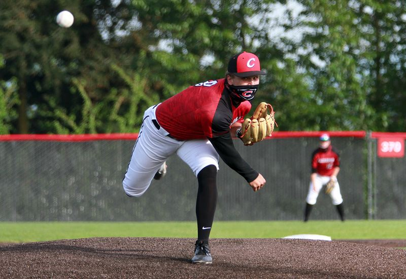 PMG PHOTO: MILES VANCE - Clackamas junior pitcher Jackson Jaha was almost unhittable in his team's 5-1 home win over Sandy on Thursday, April 29, allowing just one run in three hits while striking out 14.