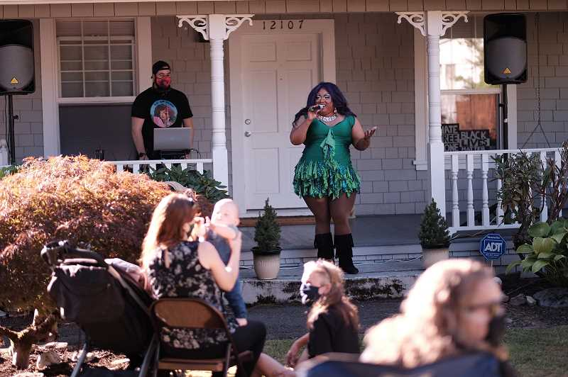 COURTESY PHOTO: HAMID SHIBATA BENNETT - Coco Jem Holiday performs during a drag show as part of the 2020 Porchfest series in Milwaukie.