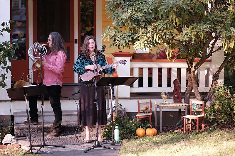 COURTESY PHOTO: HAMID SHIBATA BENNETT - Kate Morrison and Gavin Bondy perform during the 2020 Porchfest series in Milwaukie.