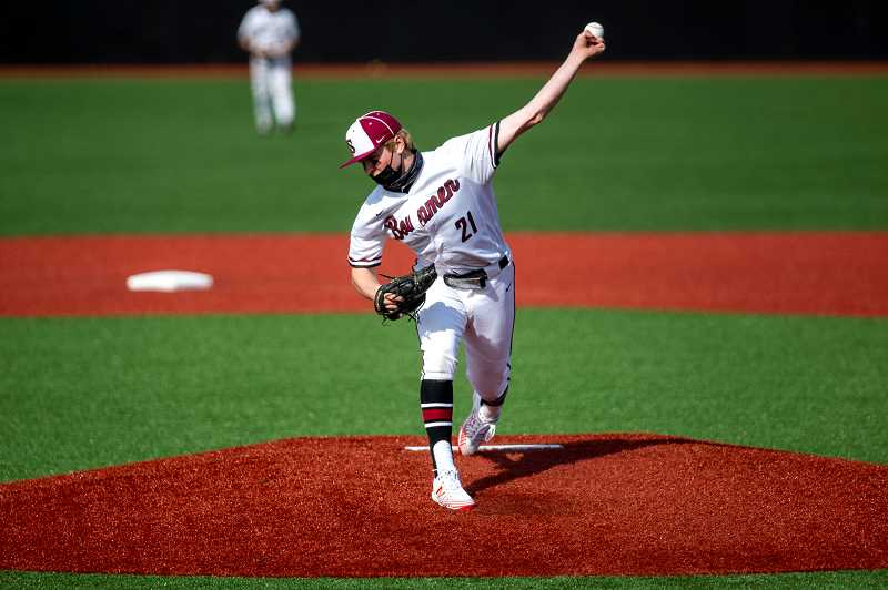 PMG PHOTO: JAIME VALDEZ - Sherwood's Ian Umlandt hurls a pitch during the Bowmen's game versus Newberg Tuesday, April 27. Umlandt is committed to play baseball for the Oregon Ducks.