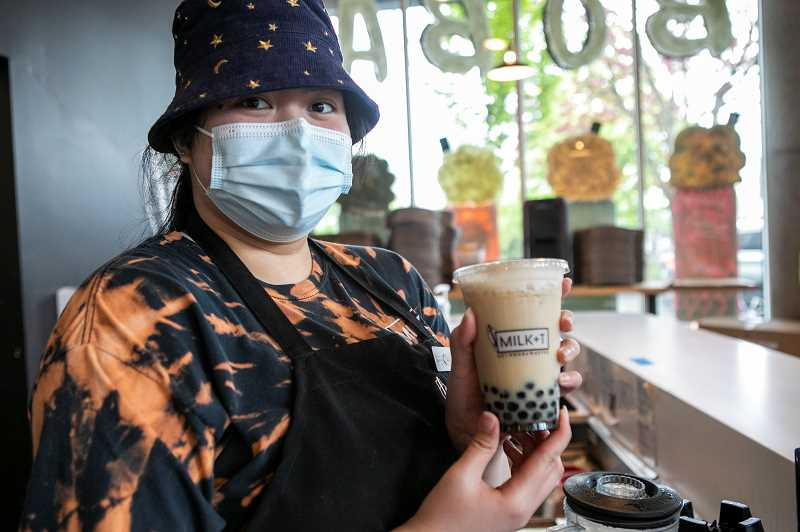PMG PHOTO: JAIME VALDEZ - Alia Reyes, who works at MILK+T in downtown Beaverton, holds a bubble tea she made for a customer.