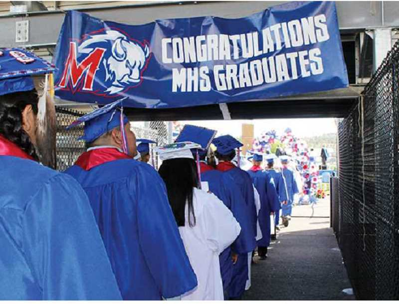 PIONEER FILE PHOTO - Madras and Bridges seniors will graduate during outdoor ceremonies at the football stadium Saturday, June 5. Tickets will be required for guests.