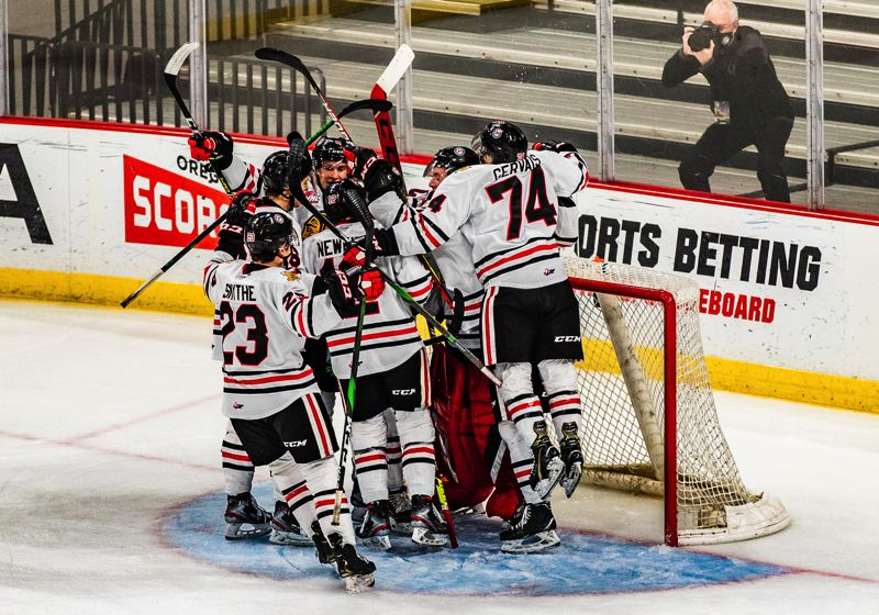 COURTESY PHOTO: MATTHEW WOLFE/PORTLAND WINTERHAWKS - The Portland Winterhawks mob goalie Dante Giannuzzi after beating Everett 5-2 on Friday, April 30, their first win of the season over the Silvertips.