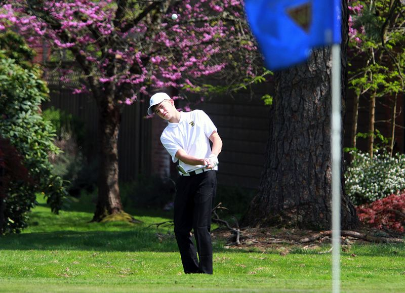 PMG PHOTO: MILES VANCE - West Linn junior Arthur Venderby chips onto the green during the Three Rivers League tournament  at Willamette Valley Country Club on Tuesday, April 27.