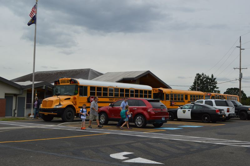 PMG FILE PHOTO - Buses line up outside of Warren Elementary School at dismissal time in 2015.