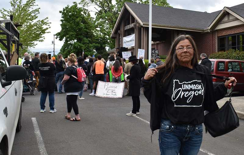 PMG PHOTO: RAYMOND RENDLEMAN - Debbie Frank of Scappose wears a T-shirt expressing the views of many May 1 protesters in Oregon City.