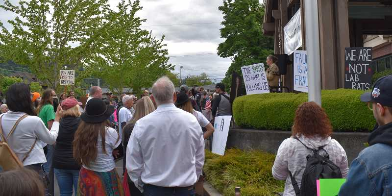 PMG PHOTO: RAYMOND RENDLEMAN - Jessica Economou, co-owner of Oregon City Records, addresses a crowd of about 200 people for a 'Medical Freedom Rally.'