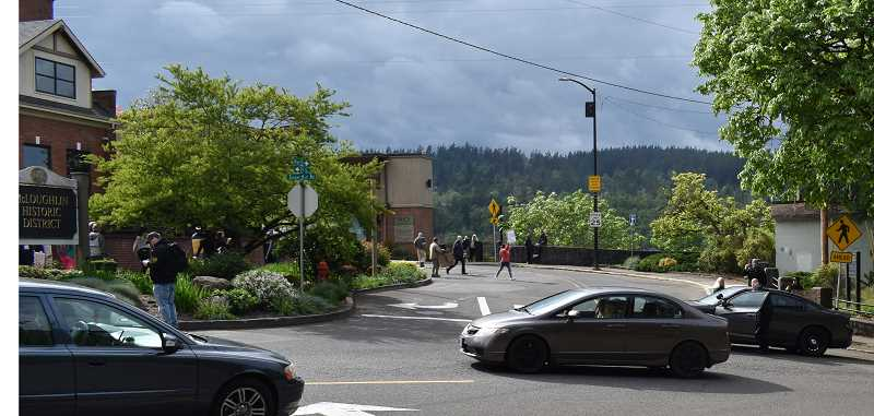 PMG PHOTO: RAYMOND RENDLEMAN - Oregon City police officers help direct traffic for the protest march against mask mandates.