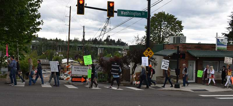 PMG PHOTO: RAYMOND RENDLEMAN - Marchers made about a mile-long loop through downtown Oregon City carrying signs related to statewide mask mandates.