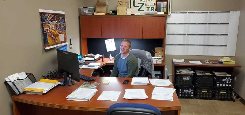 COURTESY PHOTO: CASEY GARRETT - Riley Baker sits in his office at his new job as director of general services for Columbia County.