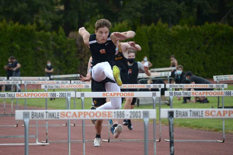 PMG PHOTO: ANNA DEL SAVIO - Scappoose senior Micah Swadley takes a close second in the 300-meter and 110-meter hurdles at an April 28 meet.