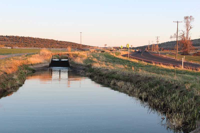 FILE - Irrigation systems like this one in Central Oregon are facing a dire lack of water.