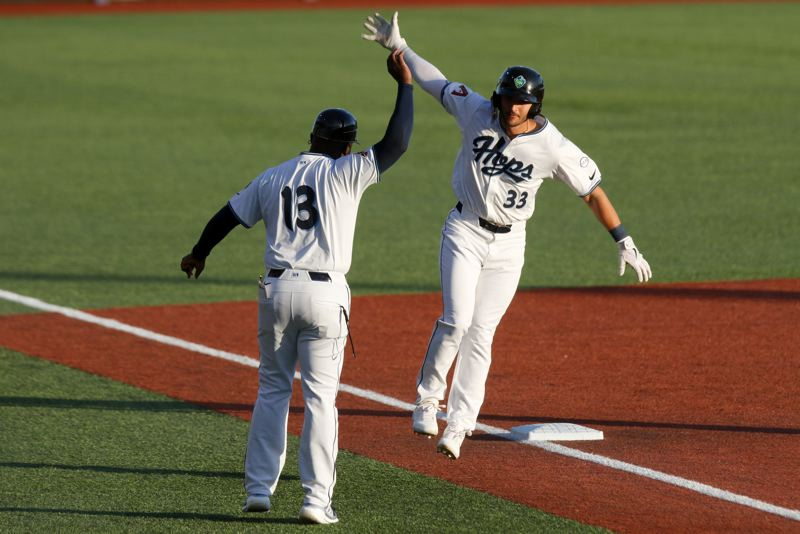PMG PHOTO: JONATHAN HOUSE - The Hillsboro Hops' Dominic Canzone and manager Vince Harrison celebrate a two-run home run off Everett AquaSox starter Matt Brash on Tuesday, May 4.