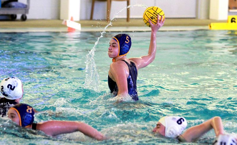 PMG PHOTO: MILES VANCE - Newberg's Hailey Day gets ready to shoot during her team's 26-14 win over Lakeridge at Chehalem Aquatic Center on Tuesday, May 4.