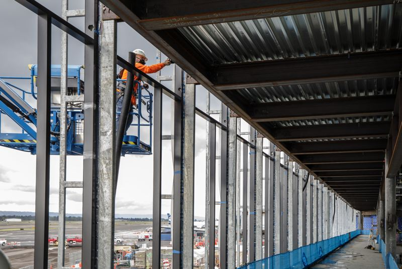 PAMPLIN MEDIA GROUP: JONATHAN HOUSE - Concourse B's curtain wall system is being hung right now. The new, huge windows, which let in light and show off the planes, are what are travelers have been asking for.