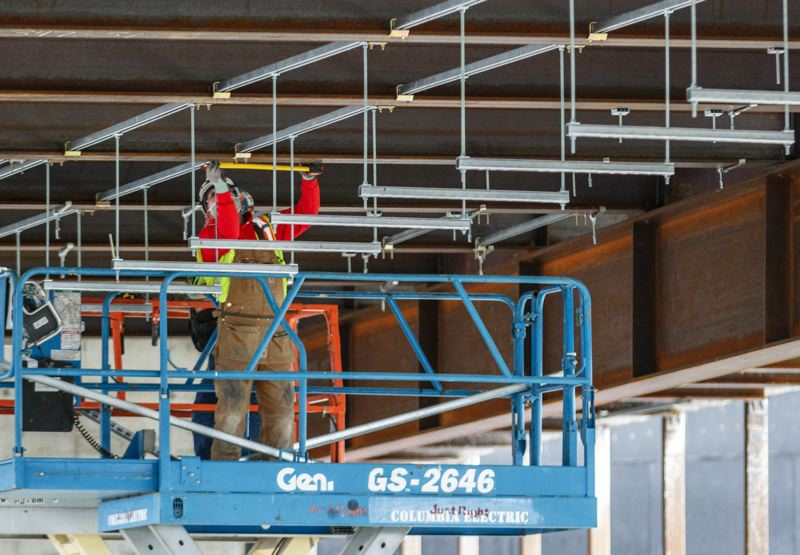 PMG PHOTO: JONATHAN HOUSE - Workers continue construction on Concourse B renovations at Portland International Airport. Mechanical, electrical and plumbing work is going on this spring.