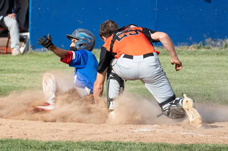LON AUSTIN  - Isarael Penaloza slides in safe at home against Molalla in the Buffs' 16-2 win.