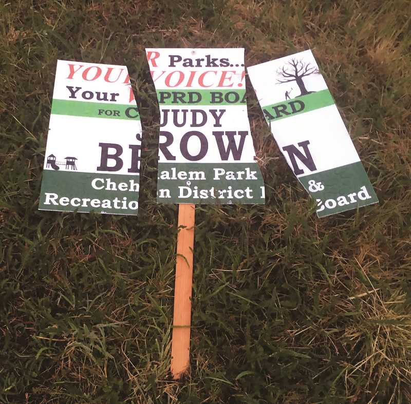 School board race devolves into political spat as signs destroyed