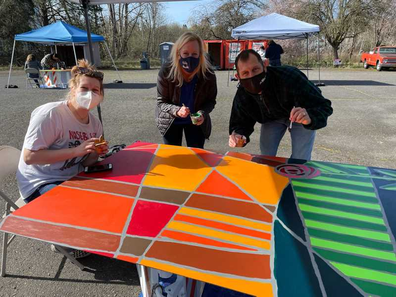 COURTESY PHOTO: STEVE DEANGELO - Tigard City Councilor Jeanette Shaw and her family participate in painting one of the panels for the Main Street mural.