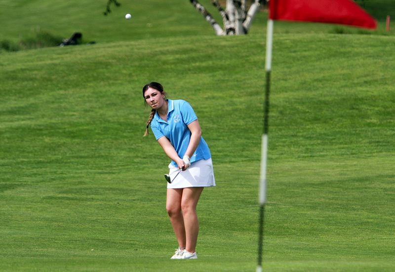 PMG PHOTO: MILES VANCE - Lakeridge senior Maddie Baker chips toward the green during the Three Rivers League tournament at the OGA Golf Course in Woodburn on Wednesday, May 5.