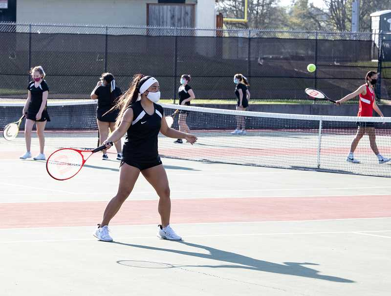 SUBMITTED PHOTO: MICHELLE NETT - The St. Helens High School girl's tennis squad observes COVID precautions on the court.