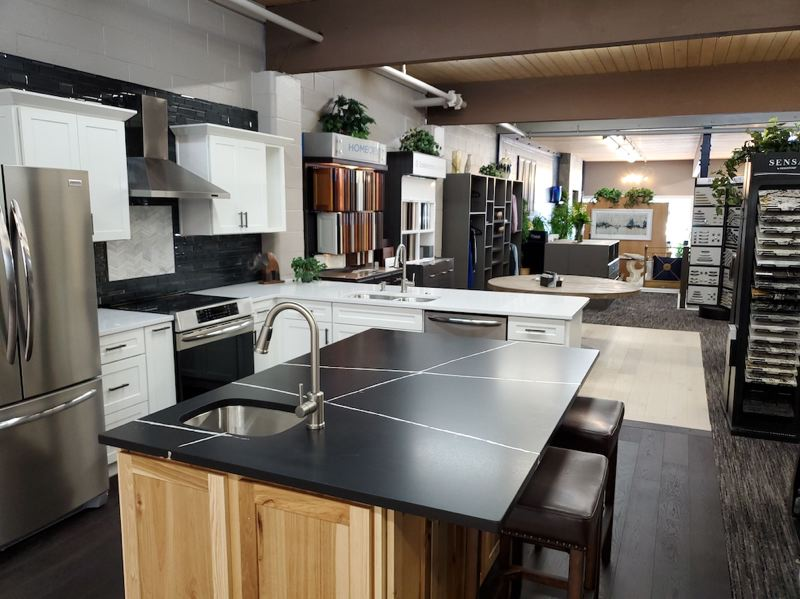 Custom NW Remodeling & Floors new showroom highlights quality products in real life settings.