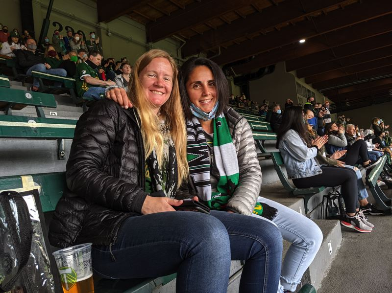 PAMPLIN MEDIA GROUP: JOSEPH GALLIVAN - Timbers fans Haz Jafari and Annie Borton are regulars in the North End at Providence Park. On Sunday they were sitting on the west stand. Just as the players came out for the noon kick off, they noticed how quiet it felt. 'It's usually packed for hours,' said Borton of the derby game experience she is used to.
