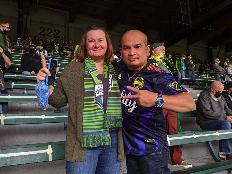PAMPLIN MEDIA GROUP: JOSEPH GALLIVAN - Sounders fans Melisa Moore and Daly Keov moved to Portland from Seattle just before the pandemic and live next to Providence Park. 'Just having fans, that's all that matters,' said Keov, an Emerald City Supporters group member who goes by Diggety. 'My voice, it echoes. I'm loud, bro.'