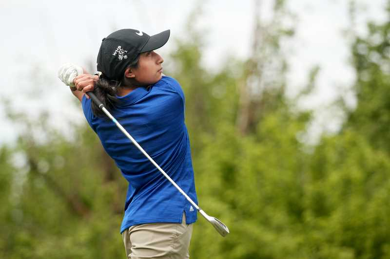 PMG PHOTO: PHIL HAWKINS - Woodburn junior Ana Sanchez tees off on the third hole at OGA golf course on May 3, placing eighth at the competition.