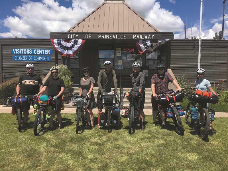 PHOTO COURTESY OF PRINEVILLE-CROOK COUNTY CHAMBER OF COMMERCE - A group of cyclists who were utilizing the resources of the Prinevile-Crook County Chamber of Commerce pause for a photo during the 2020 summer season.