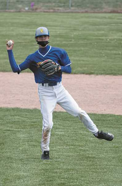 LON AUSTIN/CENTRAL OREGONIAN - Austin Vaughan, playing shortstop for the Cowboys, throws to first base to get a Riverhawk runner during Crook County's 5-4 home loss to The Dalles on May 8.