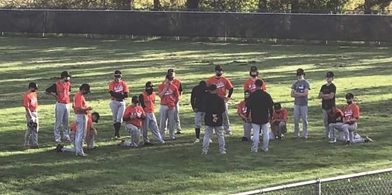 COURTESY PHOTO: GARY MILLER - Coach Gary Miller and his staff talk with the Molalla High baseball team after Monday's 12-2 win over Corbett.