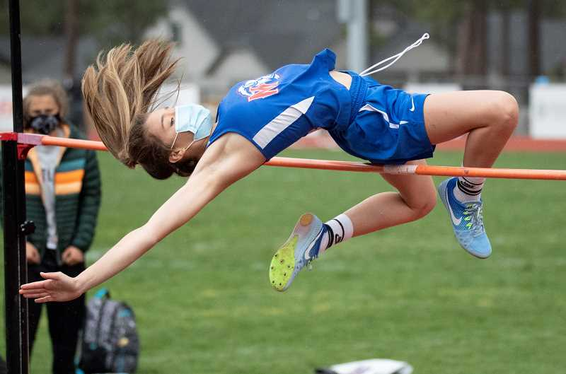 LON AUSTIN  - Illiana Hance clearns the high jump during the Sisters Invitational. She tied for first in the event, helping the White Buffalo girls to the team title. The boys also won.