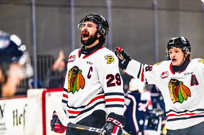COURTESY PHOTO: PORTLAND WINTERHAWKS/MATTHEW WOLFE - Portland Winterhawks' 20-year-olds Nick Cicek (29) and Mason Mannek react after teaming up for Portland's first goal in a 5-1 win over Tri-City on Tuesday at Veterans Memorial Coliseum. It was the last WHL game for Cicek and Mannek.