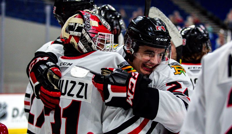 COURTESY PHOTO: PORTLAND WINTERHAWKS/MEGAN CONNELLY - Seth Jarvis (24) embraces goalie Dante Giannuzzi at the end of the Portland Winterhawks 5-1 win over Tri-City on Tuesday at Veterans Memorial Coliseum. It was the final game of the 24-game Western Hockey League season.