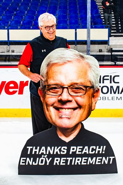 COURTESY PHOTO: PORTLAND WINTERHAWKS/MATTHEW WOLFE - Portland Winterhawks equipment manager Mark 'Peaches' Brennan poses with a sign commemorating the final game of a career in hockey that dates to 1983.
