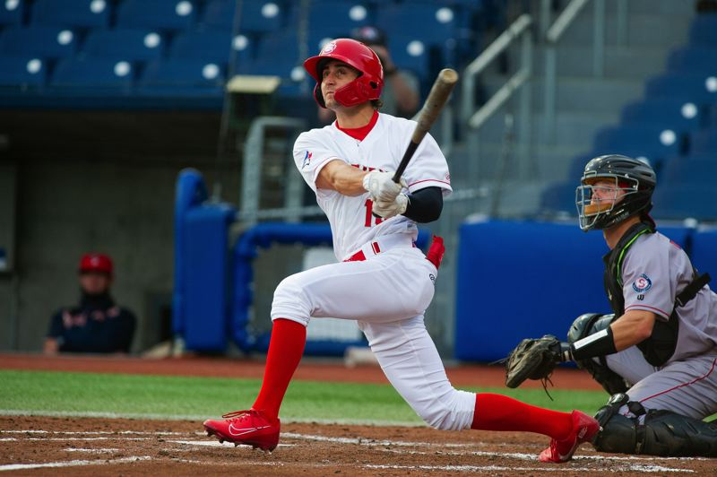 PMG PHOTO: JOHN LARIVIERE - Vancouver Canadians outfielder Tanner Kirwer hits a solo home run in the bottom of the third inning on Tuesday, May 11, at Ron Tonkin Field.