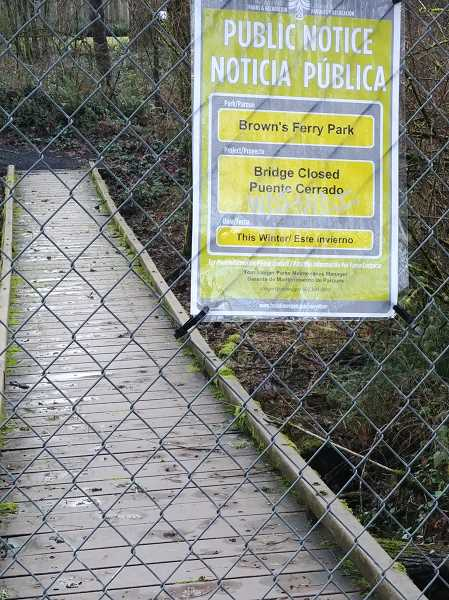 PMG FILE PHOTO - This pedestrian bridge in Browns Ferry Park, submerged underwater during January rains, is one example of a Tualatin city park amenity in need of repair.