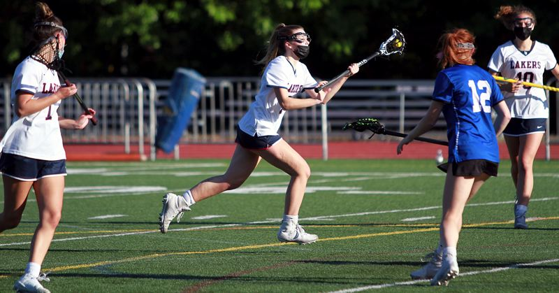 PMG PHOTO: MILES VANCE - Lake Oswego's Gabby Crist races upfield during her team's 13-3 win over St. Mary's on Wednesday, May 12, at Lake Oswego High School.