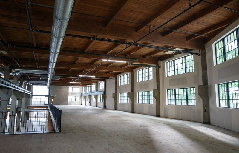 PAMPLIN MEDIA GROUP: JONATHAN HOUSE  - Premier Gear, the adaptive reuse/renovation of the Premier Gear & Machine Works factory at 1700 N.W. Thurman St., by Lorentz Bruun Construction. The large space sits empty for now while TMT Development finds a tenant who wants in-person office space after the pandemic.