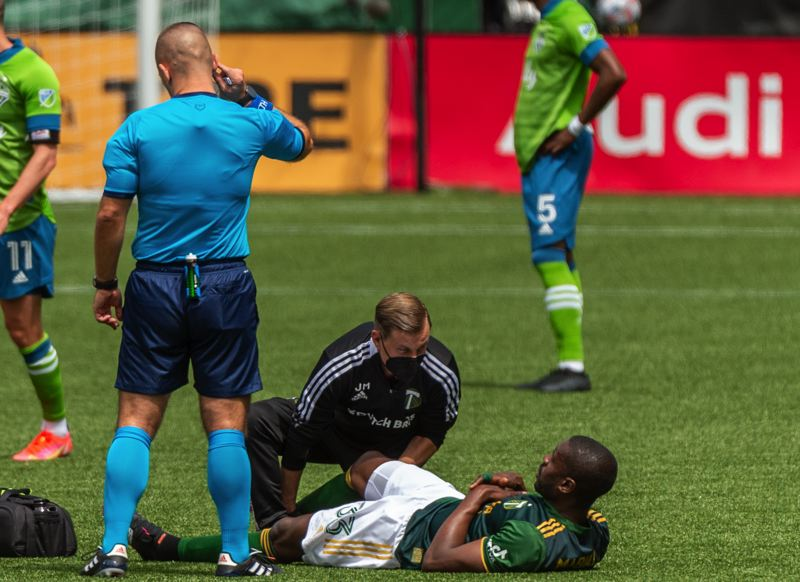 PMG PHOTO: DIEGO G. DIAZ - Timbers defender Larrys Mabiala is tended to after suffering a hamstring injury in the first half of the Sunday, May 9 loss to Seattle, adding to a significant injury list for Portland.