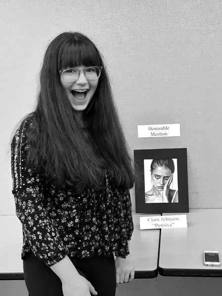 COURTESY PHOTO: CLARA JOHNSON - Clara Johnson, 17, stands next to an art piece from a previous competition. Johnson is a Beaverton High School student who won the 2021 Congressional Art Competition for Oregons First Congressional District.