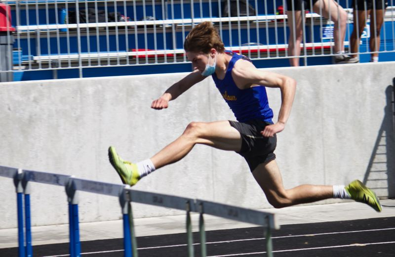 PMG PHOTO: CHRISTOPHER KEIZUR - Barlow sophomore Micah Perry flew over the hurdles en route to a victory.