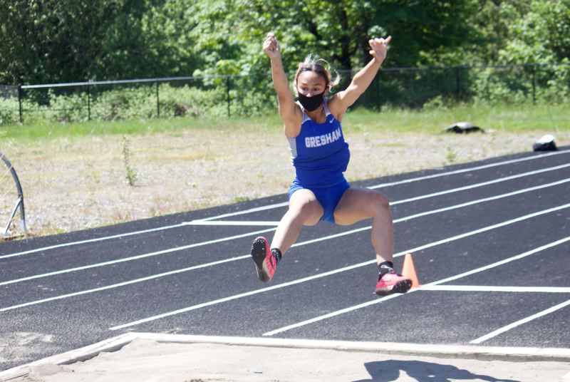 PMG PHOTO: CHRISTOPHER KEIZUR - Gresham senior Andrea Goulet claimed victory in the long jump with a personal record jump of 15-01.00.