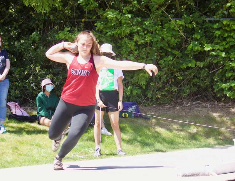 PMG PHOTO: CHRISTOPHER KEIZUR - Sandy sophomore Sydney Brewster won shot put after a duel with Barlow junior Grace Lam Tiang.