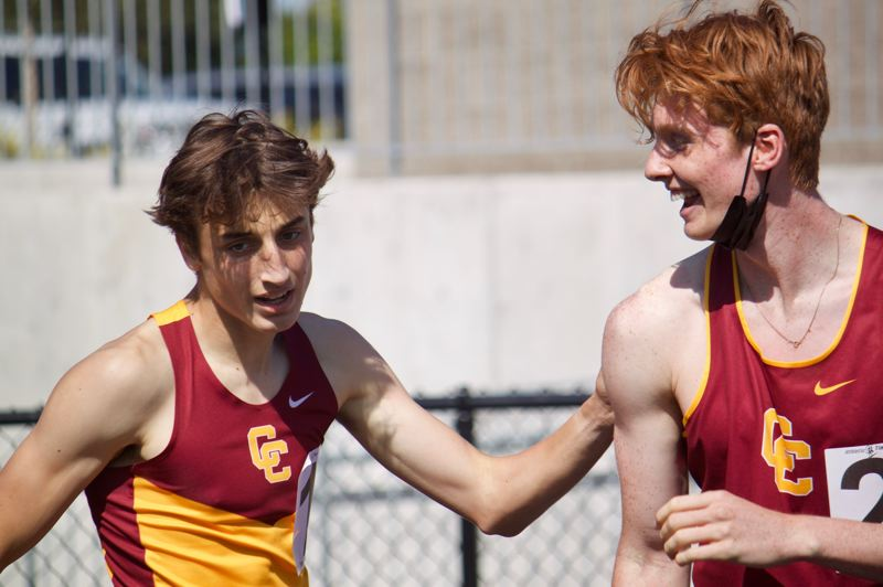 PMG PHOTO: CHRISTOPHER KEIZUR - Central Catholic sophomore Wes Shipsey, left, ran alongside junior teammate Julian Kingery for a 1-2 finish in the 800.
