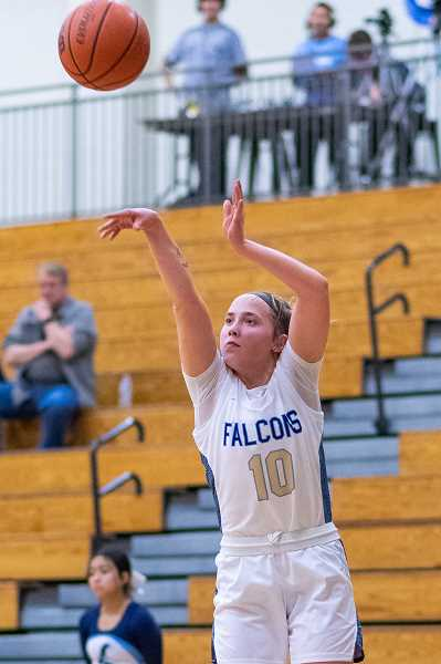 PMG FILE PHOTO - Liberty's Livia Knapp (10) during the first round of the OSAA 6A girls basketball playoffs against Westview at Liberty High School in Hillsboro, Ore., on Tuesday, March 3, 2020. Knapp will be a key contributor to this year's Falcons team.