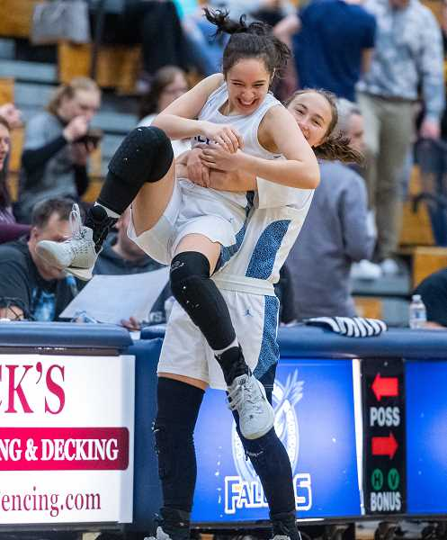 PMG FILE PHOTO - Liberty's Talia Kahakai -Wyatt (4) and Liberty's Sage Reamer (33) celebrate during a game last season. Reamer will be stepping into a starting role on this year's Falcons team.