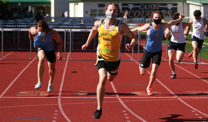 PMG PHOTO: MILES VANCE - West Linn's Adam Maxwell runs away with the victory in the 110-meter high hurdles, one of his three wins at the Three Rivers League district track meet at Canby High School on Saturday, May 15.