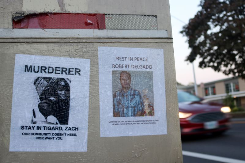 PMG PHOTO: ZANE SPARLING - Flyers regarding the fatal police shooting of Robert Delgado by Portland Police Bureau officer Zachary DeLong were pasted to a mailbox across the street from Tigard High School on Sunday, May 16.
